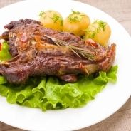 Lamb recipe with cumin couscous and fruits with honey