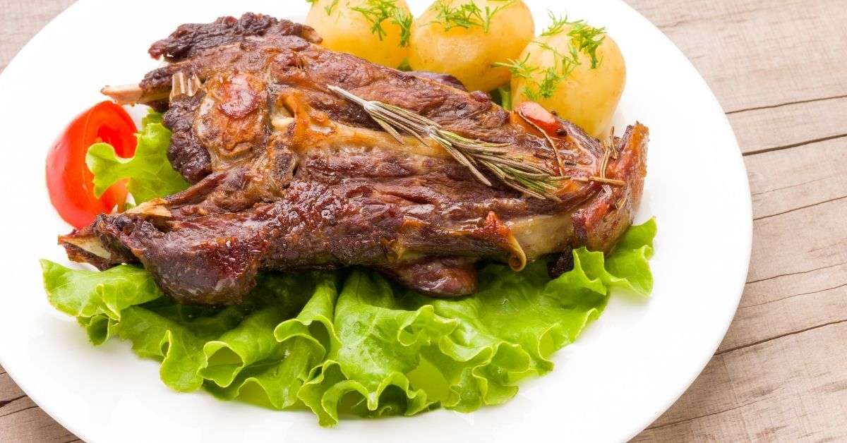 Lamb with cumin couscous and fruits with honey