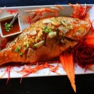 Baked snapper on its bed of potatoes recipe