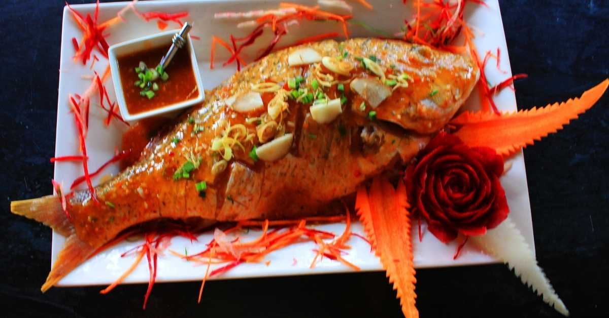 Baked snapper on its bed of potatoes